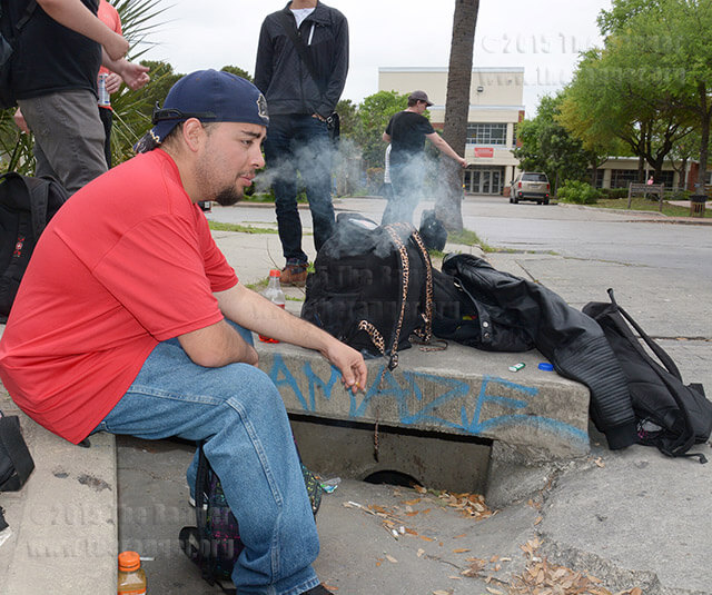 "Loftin cook Thomas Mejia smokes a cigarette Monday at Dewey and Belknap on his day off. Mejia said it's nice to take a smoking break and talk to friends. ""Everyone is stressed out from class so it's nice to come here to relax,"" he said.  Photo by Neven Jones"