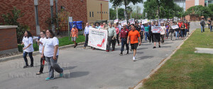 Members of the Non-Traditional Student Club lead Walk A Mile In Her Shoes from Loftin to the empowerment center. Employees and students marched together to raise awareness of rape, sexual assault and gender violence.  Photo by Jon Hernandez
