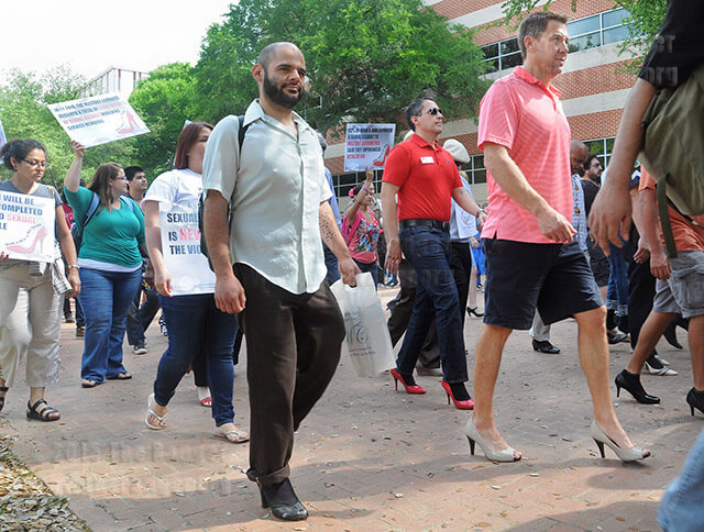 Richard Farias, director of student life, and kinesiology Chair Brad Dudney march in heels from Loftin to the Empowerment Center to raise awareness about rape and sexual assault.  Photo by Jon Hernandez