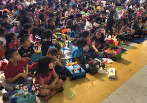 Students of Margil Elementary settle down as David Mrizek, vice president of college services, prepares to read to them.