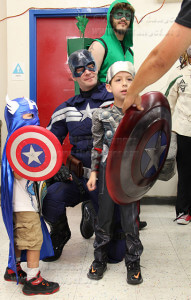 Kaidanse Paredes, 3, and Dahvin Paredes, 7, meet character Captain America at the Free Comic Book Day event at Heroes and Fantasies, 4923 Northwest Loop 410.  Photo by Cynthia M. Herrera.