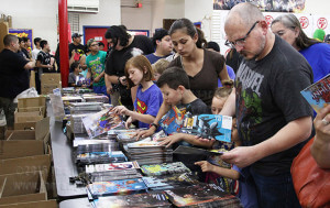Comic book fans choose their free comics among 50 titles during Free Comic Book Day May 2 at Heroes and Fantasies, 4923 Northwest Loop 410. Free Comic Book Day started May 4, 2002 and is every first Saturday in May.  Photo by Cynthia M. Herrera