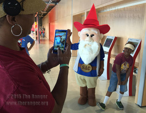 Jalise King-Vance takes a picture of her son Mikyl R. Vance Jr., 9, with the Gnome Ranger during the grand opening of the Welcome Center May 22. Photo by E. David Guel