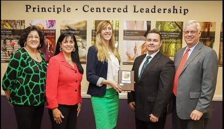 "District Wellness Coordinator Chris Dillon, fourth from left, and other district administrators accept the Gold Level award for ""Fit and Friendly Organization on behalf of the American Heart Assocation. Courtesy Photo"