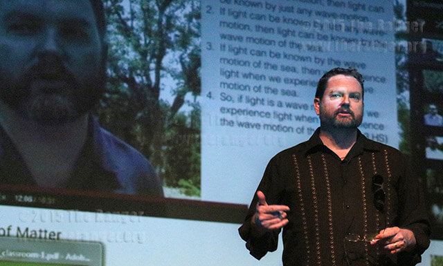 "Philosophy adjunct Dr. Christopher Haugen encourages instructors to incorporate video lectures into the classroom Wednesday during ""Get Flipped: Teaching with Technology"" convocation in McAllister. Haugen said, ""THe minimal amount of effort when producing these videos has a really high return, because of the student's abilities to use that video over and over again."" Photo by E. David Guel"