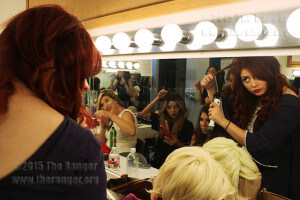 """Performers Lisa Marie Barecas, Veronica Gallegos, Madalyn Mendoza and Laura Elizabeth do last-minute touch-ups moments before the opening act of the Gridiron. The San Antonio Chapter of the Society of Professional Journalists hosted the Gridiron 2015 """"Bad Blood"""" Sept. 19 at McAllister Auditorium. Photo by Danielle Kelly"""