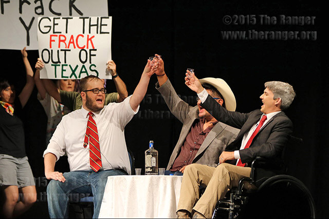 "Performers Tyler White, Joey Palacios and Mark D. Wilson toast in the ""Super Frack"" skit during the Gridiron. The San Antonio Chapter of the Society of Professional Journalists hosted the Gridiron 2015 ""Bad Blood"" Sept. 19 at McAllister Auditorium. Photo by Danielle Kelly"