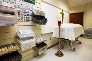 Samples of burial vaults and a casket covered by a pall are displayed Sept. 9 in mortuary science's merchandise room in Nail. Students use the room to practice showing customers a funeral home's merchandise room. Photo by Daniel Carde