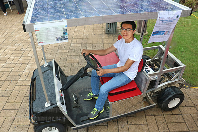 Engineering freshman Julio Banda sits in the solar-powered cart he helped build as a summer undergraduate research project at the STEMulate science showcase Sept. 16 in the mall. The Mesa Mobile, built on a grant from the National Science Foundation, took 15 weeks to construct and was completed Sept. 15. Banda said the cart will be used to promote STEM around campus. Photo by Daniel Carde