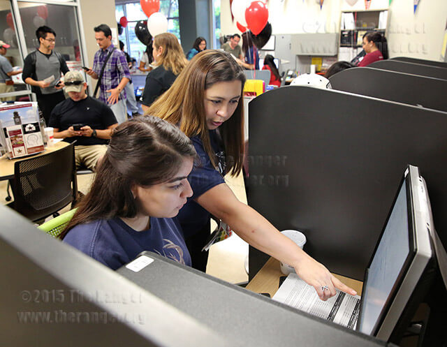 Certified adviser Melissa Zepeda assists forensics sophomore Brianna Ramos with finding information about Purdue University's anthropology transfer program Sept. 21 in the transfer center on the first floor of Moody. The center is open from 8 a.m.-5 p.m. Monday, Wednesday, Thursday and Friday, and from 8 a.m.-7 p.m. Tuesday. Photo by Daniel Carde
