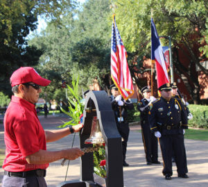 "Fire academy Instructor Abel Campos rings the fire bell at this college's 9-11 rememberance cermony as the Alamo Colleges' honor guard led by Cpl. Christopher Hernandez stands at attention presenting the colors. The ringing of the bell is a tradition called ""striking the four fives."" The bell is struck five times in a series of four to signify a firefighter died in the line of duty or an important offical died. The tradition dates back as far as 1865 when the New York Fire Department informed their men of the death of Abraham Lincoln. Photo by Kyle R. Cotton"