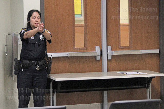Corporal Marisa Saccio gives a demonstration in 2013 of blocking doors in case a shooter tries to go in a classroom in Room 208 of the nursing complex. File