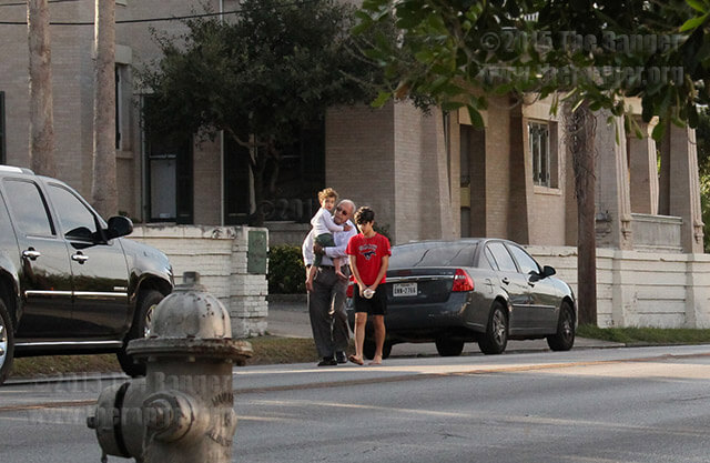 Two of the three children involved in a hostage situation are escorted by a family member to another location just after 9 a.m. today in the 500 block of West French Place. The children's father was not arrested on scene, but SAPD Chief William McManus said officers would be back to serve him with a warrant at a later date. Photo by Cynthia M. Herrera