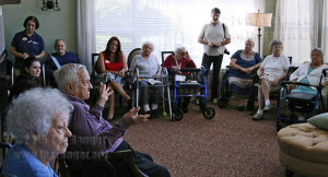 John Igo, retired English professor from this college, explains the importance of the John Igo Health and Wellness Resource Center to residents and staff Sept. 23 in the Sun Room at Brookdale Hamilton Wolfe Senior Living at 5331 Hamilton Wolfe Road. Photo by Kyle R. Cotton