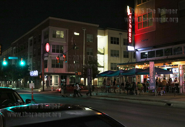 Club-goers walk across the street to Luther's Cafe at 1503 N. Main Sept. 30. Psychology sophmore and Tobin Lofts resident Asia Thompson said she has seen an increase of incidents since Luther's moved to that corner. David Mendelson, a manager for Luther's Cafe, said the establishment has been on North Main since 1976 and would not have caused an increase in crime. Photo by Kyle R. Cotton