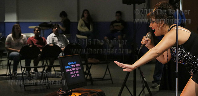 "Music business sophomore Justine Villarreal sings a cover of Stevie Nick's ""Edge of Seventeen"" Sept. 14 during the first karaoke session of the semester sponsored by student life in the Fiesta Room of Loftin. The next karaoke event will be 11 a.m.-1 p.m. Oct. 5 with free popcorn provided by student life. Photo by E. David Guel"