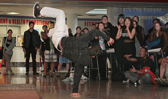 Kinesiology sophomore Raul Riojas breakdances during a talent show sponsored by the office of student life and the campus activities board Wednesday in the Fiesta Room of Loftin. Riojas won an Amazon Kindle Fire for first place. Nine acts performed in front of more than 60 people. Photo by E. David Guel