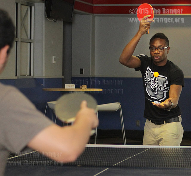 "Business administration sophomore Michael Ogungbemi serves the ball to business administration freshman Jose Lopez during the first round of a pingpong tournament Wednesday in Loftin. Ogungbemi won the tournament for the second time. ""He was last semester's reigning champ,"" said Marisa Martinez, senior specialist for student success. Ogungbemi beat business freshman Rickey Perez in the final match. He won a Sony digital camera. Photo by Pam Paz"