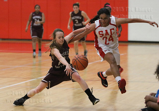 Pirates freshman guard Jaycie Orsak muscles past architecture sophomore Alexa Mallen for possesion of the ball in the third quarter of the Oct. 14 game between the Lady Rangers and the Lady Pirates in Gym 1 of Candler. Orsak and Mallen both scored 10 points in the Victoria's 62-53 victory. Photo by E. David Guel