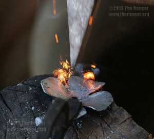 Ruiz strikes the hot steel clover to create a natural floral pattern at his Volundr Forge in Adkins. Photo by Kyle R. Cotton