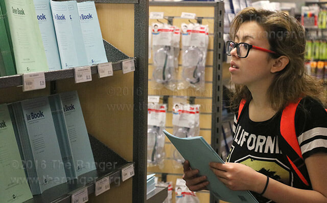 Pre-nursing freshman Amber Garcia browses through the selection of scantrons and blue books at the college bookstore.  File