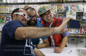 "Jason Olivarri takes a selfie with artist Ninjalnk (Tim Lim), right, and his representative Matthew Skinner at the midnight release of the new ""Back to the Future"" comic series from IDW publishing Oct. 21 at Heroes & Fantasies 4923 NW Loop 410. Prizes were handed out and a replica of the DeLorean sat out front for fans to take photos with. Photo by Danielle Kelly"
