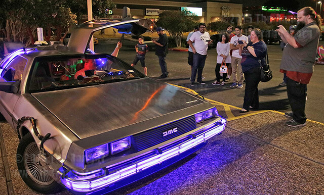 "A replica of the DeLorean sits out front for fans to pose with at the midnight release of the new ""Back to the Future"" comic series at Heroes & Fantasies NW Loop 410 Oct. 20. Inside the store, prizes were being given out and artist Ninjalnk (Tim Lim) was signing copies of the newly purchased comic. Photo by Danielle Kelly"