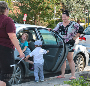 Education freshman Amber Auclair holds the car door open for her son Brett, 3, while leaving daycare Sept. 30 at the early childhood development center. Alice, 5, came along to pick up her brother in his first semester of daycare. Photo by E. David Guel
