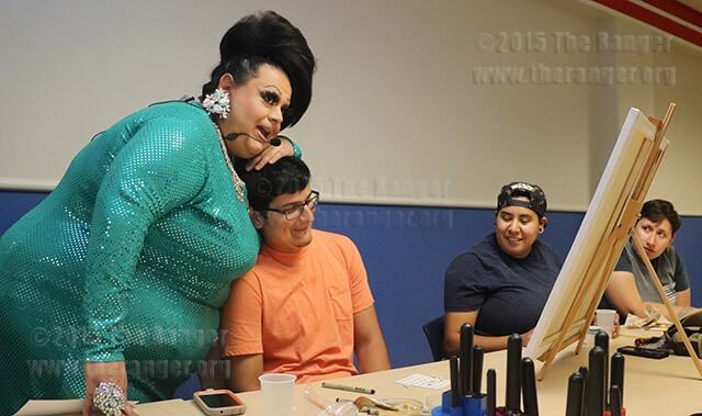 Drag queen Alayna Marquez of Rey Lopez Entertainment congratulates visual arts sophomore Lee Cantu on winning bingo Oct. 14 in Loftin. The Gay, Ally and Lesbian Alliance hosted drag bingo in celebration of Coming Out Week. Photo by Danielle Kelly