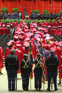 Graduates of this college and Travis Early College High School walk to their seats during the procession for the 2016 commencement Saturday at Freeman Coliseum. File