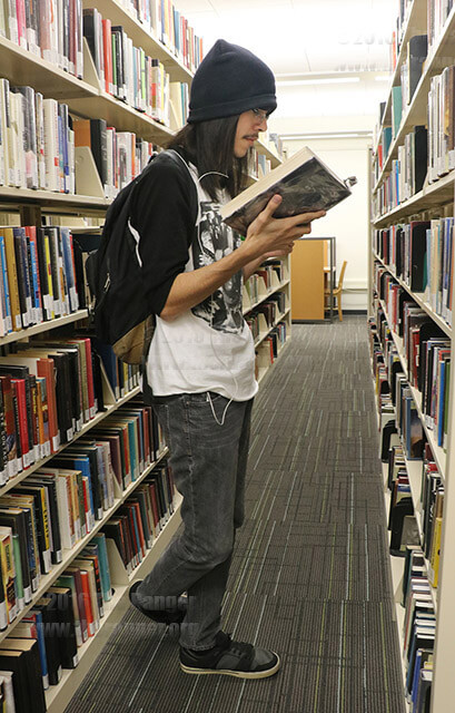 Mortuary science sophomore Keith Arroyo browses Anne Rice books while deciding on which one he will give a story telling presentation over for his English final exam. The hours for the library the week of finals May 9-13 are 8 a.m.-8 p.m. Monday-Thursday, 8 a.m.- 4 p.m. Friday and 9:30 a.m.- 5 p.m. Saturday. To get information on library hours for the summer, call (210) 486-0554. Photo by Areana Rodriguez