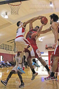 Cardinal guard Marcus Perez stuffs criminal justice sophomore John McVea as he goes up for the layup. Photo by Kyle R. Cotton