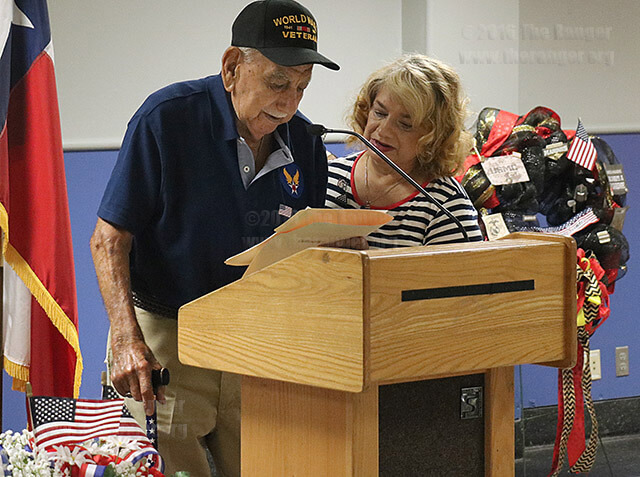 Master Tech Sgt. Angel Alfonso Cruz Sr. and his daughter, English Professor Norma Cruz-Gonzales, speak about Cruz's experience during his service in World War II during this college's Memorial Day ceremony Monday in Loftin. Cruz talked about the happiness and disbelief he felt in the Pacific when he found out the Allies had won the war. Cruz-Gonzales took over for her father mid-speech when he could not speak comfortably after recent throat surgery. Cruz-Gonzales said Cruz, 94, recently was recognized by the Smithsonian Institution as one of the oldest living Hispanic veterans of World War II. Photo by Wally Perez