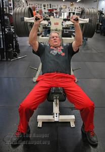 History Professor Mike Settles lifts 225 pounds on the incline press as part of his training Oct. 16. He works out three times a week at Olympic gym, 8611 N. New Braunfels Ave. and completes various repetitions on multiple machines. Photo by Melissa Luna