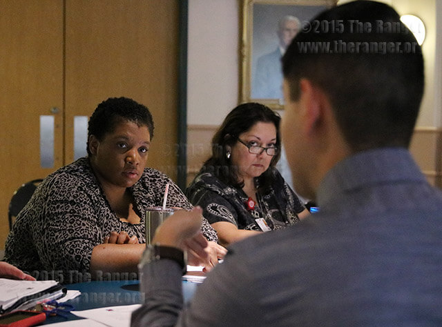 Staff Council President Jacob-Aiden Martinez talks to Parliamentarian Dee Dixon and Vice President Judy Rivas about employee of the month updates. The Staff Council will meet 2:30 p.m. Oct. 3 in the emplyee loung of Loftin. Photo by Danielle Kelly
