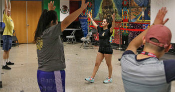 "Registered Zumba instructor Selena De La Fuenta stetches with students Thursday in the Fiesta Room of Loftin. De La Fuenta taught fine arts sophomore Patrick Hawbecker, prenursing freshman Brittany Zavala and business administration sophomore Nikki Star Zumba moves in an effort to get students active. Only three students were present for the class. ""It's usually between 15 and 30,"" De La Fuenta said about the number of students in attendance. ""I'm thinking it was midterms and the rain. Sometimes we get more people, sometimes we get less.""  Photo by Zachary-Taylor Wright"
