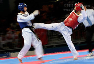 Participants compete during a 54kg Taekwondo match at Asian Games in Doha, Qatar, Dec. 7, 2006. AccuNet/AP multimedia