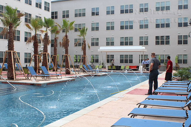 Contractors test the deck jets installed alongside the swimming pool Aug. 26 at Tobin Lofts. The pool opened Labor Day weekend and residents began moving in Aug. 23. Daniel Arguelles