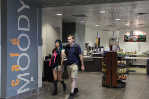 Nursing freshmen Enhjeong and Mike Wildman walk out of the new Café Moody on the second floor of Moody. Monica Lamadrid