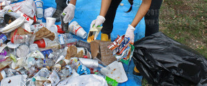 Members of SEA sort through items thrown away in the bins of the mall Thursday. They analyzed the trash prior to seperating the items thrown away and after to show how much students recycle, they ended up with 39.9% of recycled materials vs. 60.1% of trash outside Loftin's trash bins. Photo by April Dawn Genao