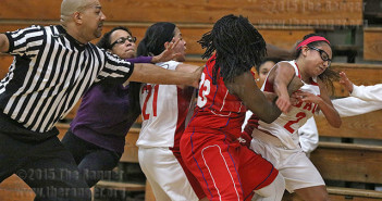 Kinesiology freshman Destiny Solis and Cowgirls post player Robin Hill exchange blows in an altercation that erupted in Wednesday's game between this college and Southwest Texas Junior College. Photo by E. David Guel