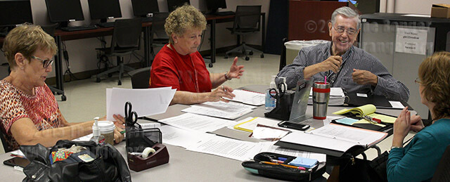 The Adjunct Faculty Council discuss revisions for the adjunct faculty handbook Oct. 21 in Room 122 of Gonzales. Most of the suggestions were cutting out non-applicable sections and adding sections more suited to the current adjunct faculty. Photo by Hillary E. Ratcliff