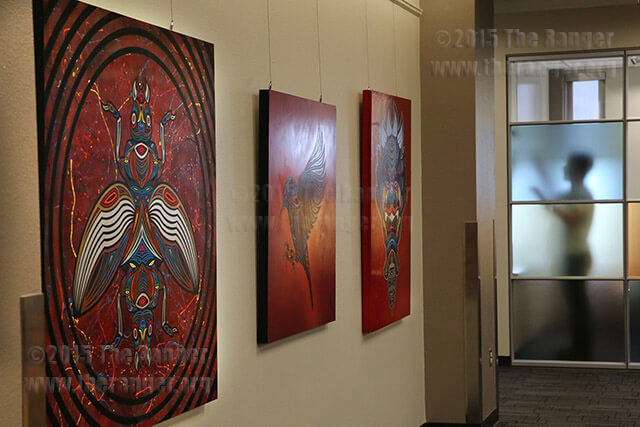 Artist and designer David Peche's art hangs Sept. 8 in the fourth floor library of Moody. Peche's opening reception was Sept. 10. The exhibit will run until Dec. 4. Photo by Daniel Carde