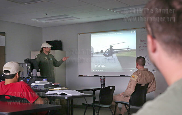 Professional pilot freshman Timothy Norwood presents a YouTube video practicing autorotation Oct. 22 at Stinson Municipal Airport. Autorotation is an emergency landing manuever used if the rotor wings lose power from the engine. Photo by Daniel Carde