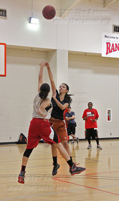 Liberal arts sophomore Shadia Williams blocks veterinary freshman Scarlett Suarez during a one-on-one drill during women's basketball tryouts Sept. 6 in Candler. Daniel Arguelles