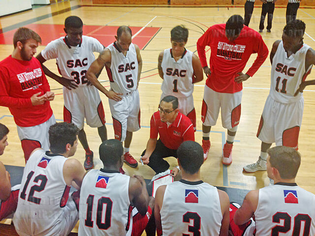 Coach Louis Martinez gives a pep talk to the Rangers, down by 6 points, during a timeout with 6:37 remaining in the second half of the Oct. 26 game against the Wildcats in Gym 1 of Candler. The Wildcats won 79-71. Photo by Alejandro Diaz