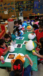 Children paint papier-mâché planets in Graciela Arizmendi's Head Start class at Carvajal Early Childhood Education Center in April. The class was preparing for a Micronaut mission to Scobee Planetarium. Courtesy Photo