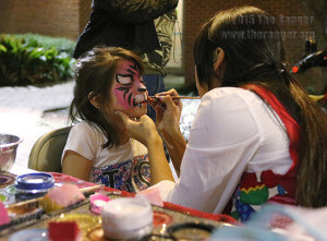 Rebecca Bradshaw, 6, gets a pink tiger painted on her face at the face painting booth at SACtacular Nov. 6 in the mall area. Various organizations were set up along the walkway, along with food trucks and live music. Photo by Danielle Kelly