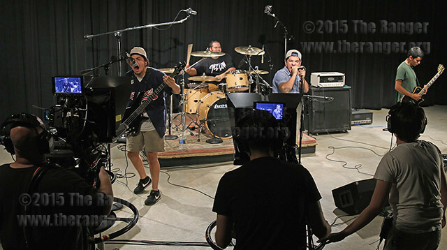 Local metal band Buried Under Texas performs for the Commercial Music Project class Oct. 2 in Longwith. The students are working on the Sound of Science project in which bands perform in class live every Friday. Photo by Danielle Kelly