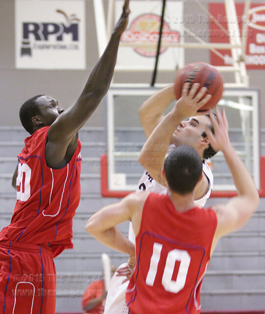 Victoria guard Zack Hoffmaster uses the double coverage to his advantage by drawing the foul. Carlos Ferrand